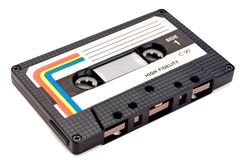 A vintage cassette tape on white. A horizontal close up of a vintage cassette tape on white royalty free stock photography