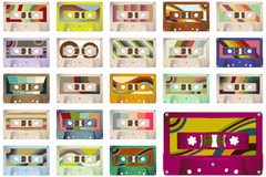 Vintage Cassette Tapes. Collection of 22 retro vintage cassette tapes with a variety of colourful decorated labels Royalty Free Stock Photo