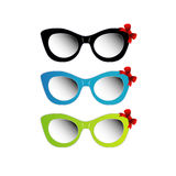 Vintage cat eye eyewear for ladies. Vintage Colorful cat eye sunglasses with red bow Stock Photo