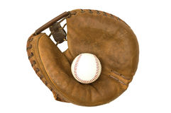 Vintage Catcher's Mitt And Ball. Isolated view of 1960s era catcher's mitt and baseball Royalty Free Stock Photo