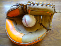 Vintage Catchers mitt with baseball. Royalty Free Stock Photo