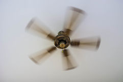 Vintage Ceiling Fan. Spinning vintage ceiling fan made of metal in brown color stock images