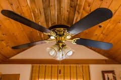 Vintage ceiling wooden fan with lamp Royalty Free Stock Photo