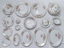 Vintage ceramic tableware set with flowers of subtle colors, 16 pieces stock photo