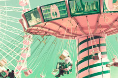 Vintage chain swing ride and ferris wheel Royalty Free Stock Photo