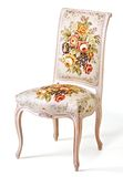Vintage chair. Vintage flowery chair isolated on white background Stock Photography