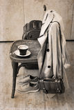 Vintage chair, classic trench,  sport shoes, suitcase, cup of coffee Stock Photo