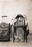 Vintage chair, classic trench,  sport shoes, suitcase, glass of wine. Artwork in retro style,  vintage chair, classic trench,  sport shoes, suitcase, glass of Stock Photography