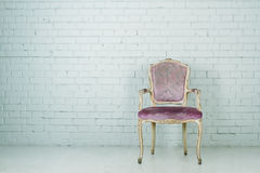 Vintage chair in empty room Stock Images
