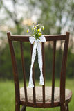 Vintage chair with a floral arrangement for ceremony Stock Image