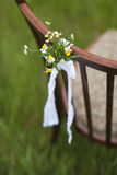 Vintage chair with a floral arrangement for ceremony Stock Photos