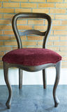 Vintage chair in front brick wall Stock Photo