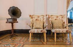 Vintage chair and gramophone in the classic room Stock Images