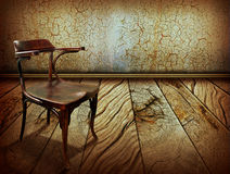 Vintage chair on old wooden floor Royalty Free Stock Photo