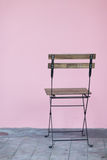Vintage chair with pink wall. Nobody Stock Photos