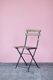 Vintage chair with pink wall. Nobody Stock Photo