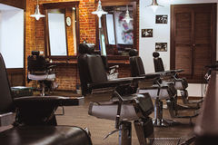 Vintage chairs in barbershop. Vintage chairs and interior in stilish barbershop stock photo