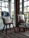Vintage chairs in a Colonial home setting bathed in natural light royalty free stock image