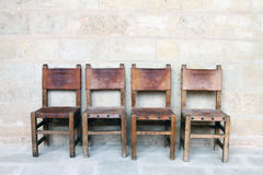 Vintage chairs at the stone wall Royalty Free Stock Image