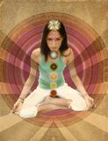 Vintage chakras girl. A young girl meditating with 7 chakras in sepia paper Stock Images