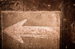 Vintage chalk arrow sign. On wood Stock Photo