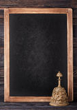 Vintage chalkboard and bell. Board menu. Stock Image
