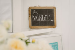 Vintage chalkboard with the motto Be Mindful. Old vintage chalkboard with a handwritten message, a motto or resolution Royalty Free Stock Photos