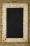 Vintage Chalkboard Reclaimed Wood Frame on Brick Wall Royalty Free Stock Photography