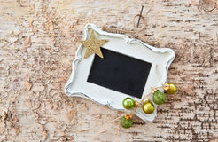 Vintage chalkboard on rustic wood Royalty Free Stock Photography