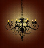 Vintage Chandelier. In a dark room with damask wallpaper Royalty Free Stock Image