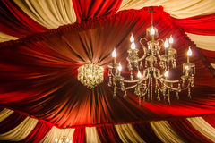 Vintage chandelier. On the background color of the ceiling fabric Stock Images