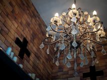 Vintage chandelier and cross stock photos