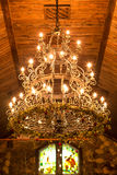 Vintage chandelier. Decorated with flowers Royalty Free Stock Photo