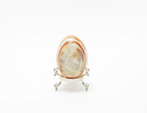 vintage charming onyx stone egg on decorated little stand Stock Image