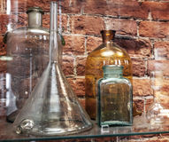 Vintage chemical ware is on the shelf royalty free stock images