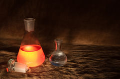 Vintage Chemistry Bottles. Close-up of two chemistry bottles with glowing liquid royalty free stock image