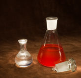 Vintage Chemistry Bottles. Close-up of two chemistry bottles with glowing liquid royalty free stock images