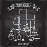 Vintage chemistry lab equipment sketch placed on old blackboard background. Stock Photo