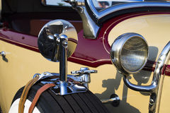 Vintage cherry and beige twenties car. Closeup Royalty Free Stock Photos