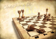 Vintage chess. Against vintage background Royalty Free Stock Photo