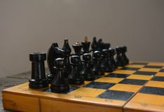 Vintage chess - board game, black figures Royalty Free Stock Photography