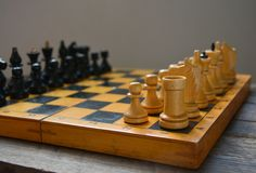 Vintage chess - board game, black figures Royalty Free Stock Photo