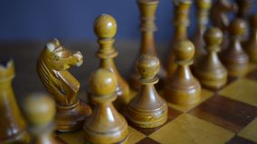 Vintage chess on board. Vintage chess set up on wooden chessboard, slide camera movement stock video footage