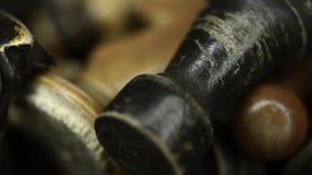 Vintage chess macro. Vintage wooden chess pieces macro, sliding camera movement stock footage