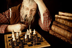 Vintage chess scene Stock Photography