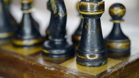 Black rook corner. Vintage chess set up on chessboard with focus on rook, sliding and pan camera movement stock footage