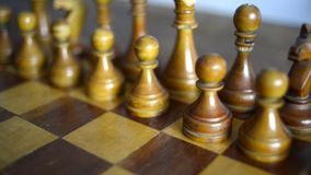 Vintage chess set up. On wooden board, slide camera movement stock video