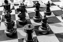 Vintage chessboard close up. Black and white photo Stock Images