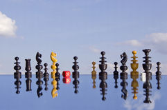 Vintage chessmans  and red dice on mirror Stock Images