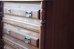 Vintage chest of drawers at an old home. Front view of a vintage chest of drawers, an old piece of family furniture Stock Photography